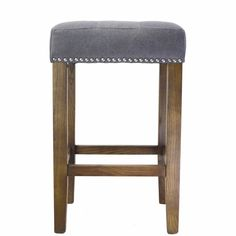 The Design Tree Home Ash Counter Stool in A Canvas/Linen blend is designed for comfort, balancing clean lines with efficient design.