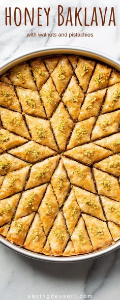 Honey Baklava Recipe - Saving Room for Dessert Honey Baklava Recipe with Walnuts and Pistachios - layers and layers of flaky phyllo slathered with melted butter, honey and loads of nuts - who can resist a slice of this delicious Honey Baklava Recipe? Walnut Recipes, Honey Recipes, Greek Recipes, Recipe With Honey, Recipes With Walnuts, Vegan Honey Recipe, Greek Dessert Recipes, Cooking With Honey, Sweets Recipes