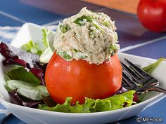 Garden Tuna Salad - Here's a fresh idea for making your canned tuna taste incredible. Stuffing it into a tomato makes it look fancy, too!
