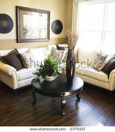 Dark hardwood flooring, light walls