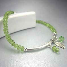 Peridot gemstone charm bracelet with sterling silver tube, August birthstone by FlauntDesignsJewelry on Etsy https://www.etsy.com/listing/130266856/peridot-gemstone-charm-bracelet-with