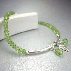 Peridot gemstone charm bracelet with sterling silver tube, August birthstone by FlauntDesignsJewelry on Etsy https://www.etsy.com/listing/130266856/peridot-gemstone-charm-bracelet-with