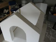 Concrete covered foam dog house.