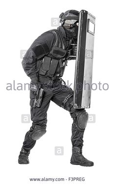 SWAT officer with ballistic shield Stock Photo