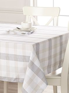 Designed in our studios exclusively for Simons Maison   This season's chic checks with a minimalist and refreshing style in soft natural beige and charcoal shades on a pure white weave.   - Very good quality polyester weave recreating the feel of natural fibres  - Easy-care, machine wash and dry  - No ironing  - Stays beautiful wash after wash  - Matching napkin also available