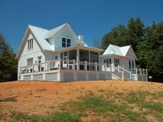 Love the batten board siding with metal roof on this new farmhouse style home