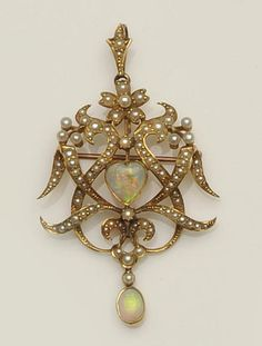 A late 19th century gold opal and seed pearl cartouche brooch/pendant  Of foliate scrolling openwork design, set throughout with flowerheads and channels of graduated seed pearls, to central collet set heart-shaped opal cabochon, suspending a similarly set oval opal cabochon drop below, the mount stamped '15ct', length 5.7cm.