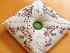 Vintage hankie pincushion