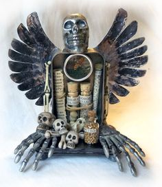 See the Altoids tin?  Could you make an assemblage like this for Dia de los Muertos?