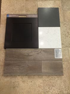 Timberlake Shaker style Kitchen cabinet with Victoria Quartz Island and Metropolis Dark perimeter countertops. Kentwood Wide plank hardwood throughout entire main floor.