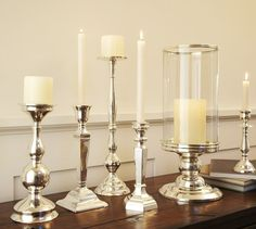 When mixed and matched, these eclectic silver plated candlesticks almost look like family heirlooms. Candle Stand, Candle Holders, Candlestick Centerpiece, Painted Candlesticks, Chandelier, Luxury Candles, Pillar Candles, Pottery Barn, Designer
