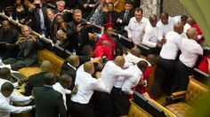 "South Africa's parliament descended into chaos as opposition politicians denounced President Jacob Zuma as a ""scoundrel"" and ""rotten to the core"" because of corruption allegations and then brawled wit"