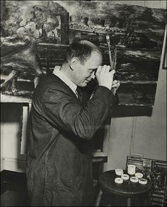 Reginald Marsh in his studio on 14th Street in New York City, overlooking Union Square