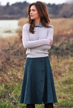 Wool cross over flair skirt, knit sweater over peter pan collared button-down