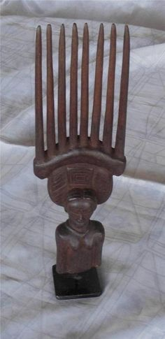 Carved Baule wooden hair comb on metal stand woman with fancy headdress 12"