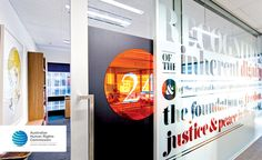 office typography - use of clear glass surrounding meeting rooms - adds color, interest, and design to the area - also a little more privacy