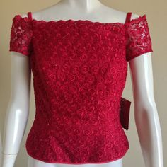 """New with Tag JS Collections Embroidered/Beaded Top Size: 4 ~ approx. 34"""" bust, 28"""" waist, 12.5"""" long from underarm to bottom Color: Red Material: polyester, nylon, acetate Condition: New with tags, as is Retail: $150.00 Note: Please ask questions on any concern prior to purchase ~ no return. Item will be shipped from an APO/FPO address. Please expect unpredictable delivery time regardless of shipping type. JS Collections Tops Blouses"""