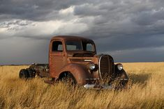 Rusty old 1939 Ford truck in a field in Southern Alberta just minutes before it started raining.
