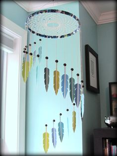 MOBILE: Dream Catcher Mobile - paint swatch mobile - paint chip mobile - feather mobile - modern - blue, turquoise, green - vegan. $100.00, via Etsy.