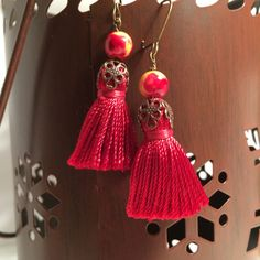 A personal favorite from my Etsy shop https://www.etsy.com/listing/259074250/sunset-tassel-earrings-sunset-color