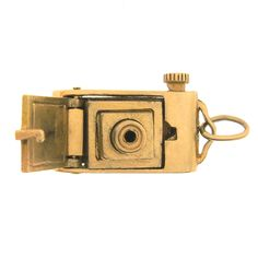 This vintage movable camera is a classic from the 1950's. The lens pops out with a push of a button! A mechanical marvel! #Charmco
