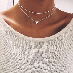 Super dainty and cute double heart choker necklace. Achieve the sweet and classic look with these fine silver lines. Only $11.99.