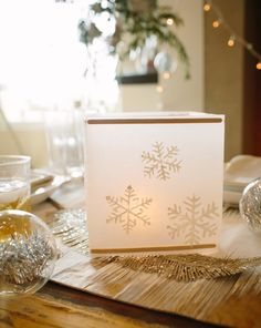 DIY Wax Paper Snowflake Lanterns by Camille Styles | @Elise West elm. So pretty!