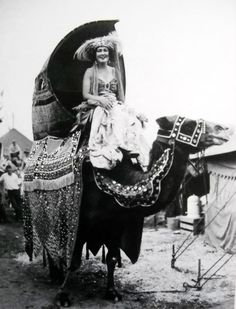 Circus lady riding a camel in 1930.oh how I would've loved being in this era.