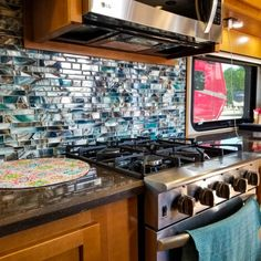 Customizable is our middle name! Find a backsplash that strikes you at Lowes/Home Depot/Menards? put it in your Luxe Luxury Fifth Wheel! Fifth Wheel Living, Lowes Home Depot, Luxury Fifth Wheel, Luxury Rv, Rv Living, Backsplash, Wheels, Middle, Kitchen Appliances
