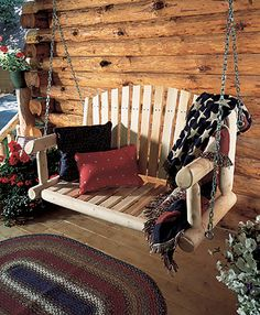Ahh... now THIS reminds me of my current house. Absolutely love porch swings and log homes.