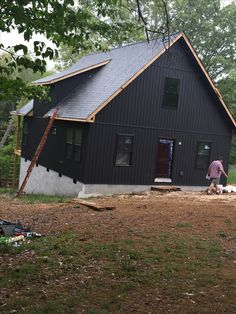 I loved this dark gray board and batten siding the moment I saw it. It really compliments the wooden door.