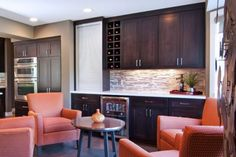 A beautifully designed wet bar can be added to any entertaining space. Dura Supreme Cabinetry Designed by Ispiri Design Build, Woodbury, MN