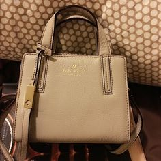 """New - Kate Spade mini satchel No trade New - what a cutest mini bag! Suitable to young girl or petite frame. Fits iphone6, small wallet, etc.  Kate Spade New York Grey Street Exotic Mini Dominique In grey street  Tassle Accent  Croc Embossed Leather  Satchel Strap Not Removable or adjustable.  Bag depth: 2.8"""" StyleShoulder Bag Bag Length6.75"""" MaterialLeather Strap Drop: 3"""" 20"""" Bag Height: 5.5"""" kate spade Bags Satchels"""