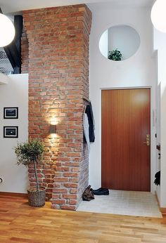 16 Attic Design Ideas To Help You Reimagine Your Space Gorgeous brick details in the entry Unique Attic Penthouse in Gothemburg, Sweden features 3 full Apartment Walls, White Apartment, Attic Apartment, Penthouse Apartment, Attic Rooms, Brick Interior, Interior Design, Brick Bedroom, Bedroom Loft