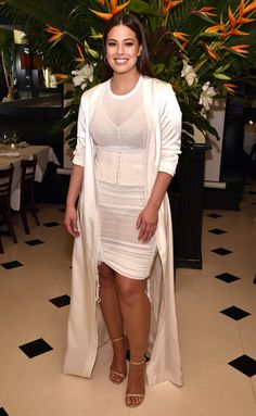 Ashley Graham in a corset dress and cream duster jacket