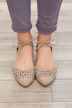 Tie front, pointed ballet flats. Available in two colors. Sizes 6-10. Man made materials. SLEVELUPTAUPE