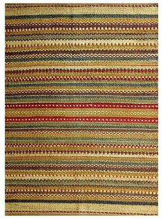 Update your home decor with this festive jute rug Floor rug is hand-woven of jute Area rug features a stripe design