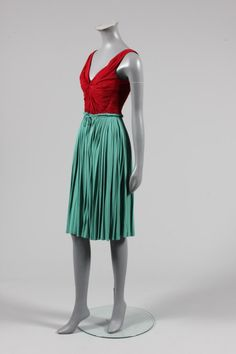 Madame Gres bi-colour draped jersey cocktail dress, circa 1945, labelled, the wine coloured bodice lined in red polka dot satin, the jade green skirt falling in vertical pleats with ruffled edge and ties to the front
