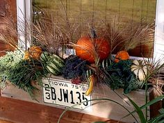 Decorating a window box for Fall.