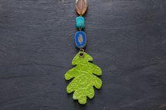 Green Leather Oak Leaf Necklace with Colorful by MusingTreeStudios  #etsy #etsyshop #etsyseller #etsyjewelry #etsyhandmade #etsyjewelry #handmade #handmadejewelry #boho #bohemian #bohochic #bohojewelry #bohostyle #bohochicjewelry #bohemianjewelry #forsale #jewelry