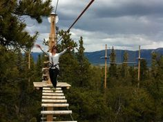 Melissa Trotter of Whistler conquers the course. That's me! Way above the treetops in #Whitehorse. :)