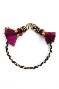 A twisted cotton cord & metal chain with lobster claw clasp & contrasting colour tassels. Handmade in India.