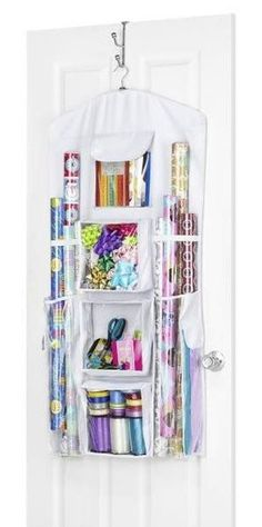 Can use this to store more than gift wrap! Use in a closet for gloves, hats, and umbrellas. Whitmor Hanging Gift Wrap Organizer in White Organisation Hacks, Storage Hacks, Craft Organization, Craft Storage, Closet Organization, Storage Ideas, Wrapping Paper Organization, Creative Storage, Towel Storage