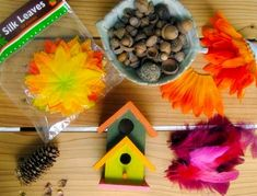 fairy houses craft materials Making Fairy Houses With Kids (crafty kids club july 2013, purchased mini birdhouses from ac moore for 60c each on sale, some moss, have mini shells, acorns tops, pinecone pieces, fake flowers and leaves, feathers, and glitter glue.