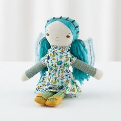 Wee Wonderfuls Dolls have soft yarn hair, delicately embroidered faces and unique outfits.  They're also very soft to the touch and versatile enough for all types of play.  How wonderful.