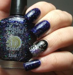New Year's Eve manicure by The Clockwise Nail Polish with Ellen Gold Laca  - a deep blue jelly with holo particles...looks like the night sky!