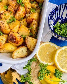 My roasted lemon greek potatoes are fast to cook & use simple ingredients: Lemon, Potatoes, greek seasoning, broth & oil. They are vegan & gluten-free. Greek Roasted Potatoes, Greek Potatoes, Lemon Potatoes, Mediterranean Vegetarian Recipes, Mediterranean Dishes, Side Dishes Easy, Side Dish Recipes, Top Recipes, Greek Recipes