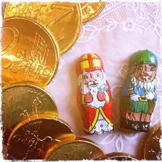 Traditionally, Sinterklaas did not only give presents but also money and food, these days represented by chocolate coins and chocolate figurines.