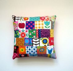 patchy cushion! my place has no solid color scheme, so the more the merrier.