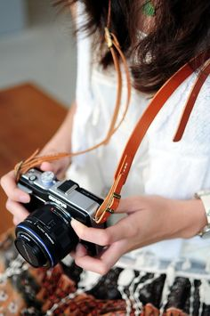 A durable camera strap made of Italian leather.